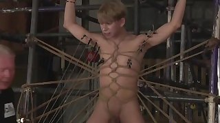 Young sub twink Daniel Hausser tied up in BDSM dungeon