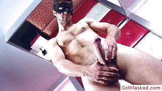 Masked stud stroking his nice firm cock