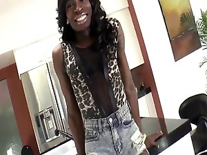 Ebony trans babe wanks her big cock